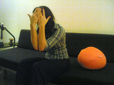Ganoée hiding her face
